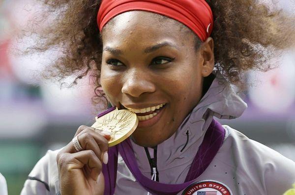 Serena Williams poses during the podium ceremony of