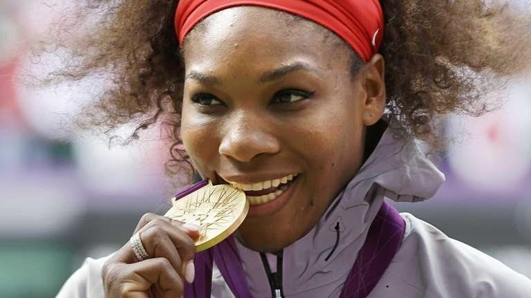 Serena Williams poses during the podium ceremony of