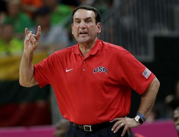 USA coach Mike Krzyzewski signals to players during