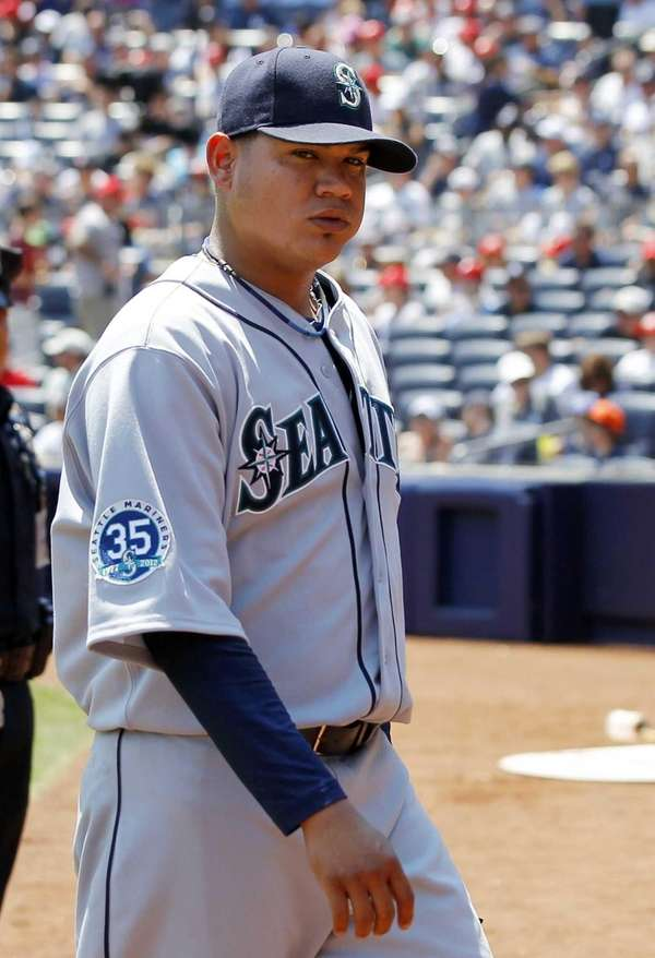 Felix Hernandez looks on after pitching the first