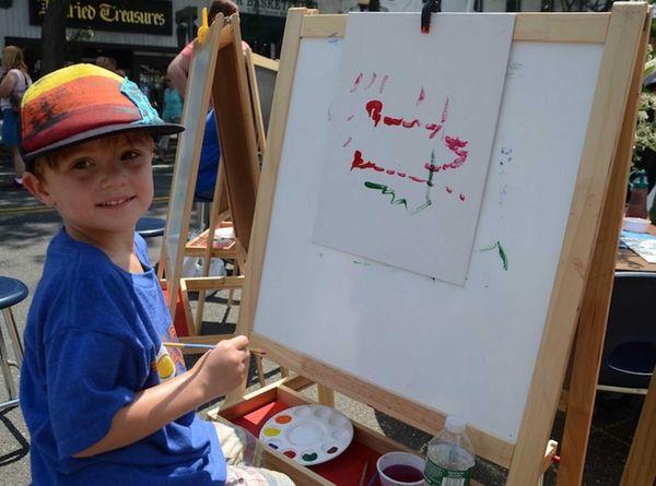 Mason Mandaro, 4, of Sayville, paints a train