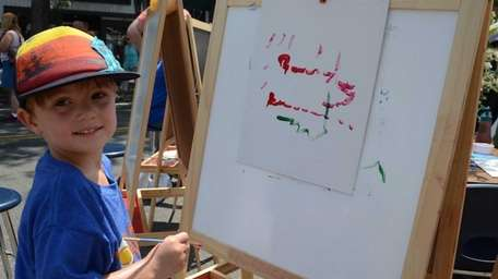 Mason Mandaro, 4, of Sayville, paints a train