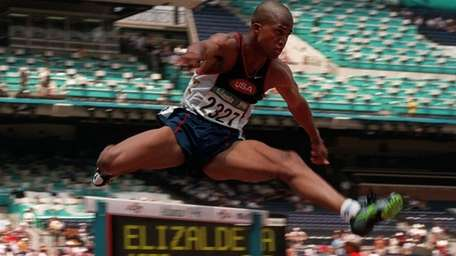 Derrick Adkins of the United States clears a