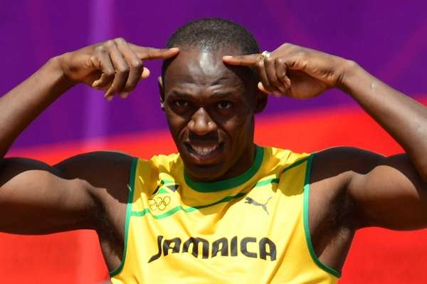 Jamaica's Usain Bolt gestures before competing in the
