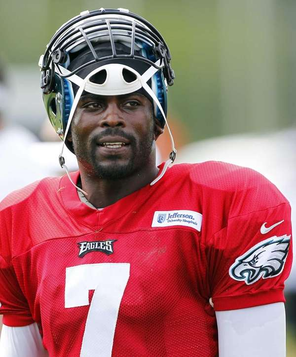 Philadelphia Eagles quarterback Michael Vick watches from the