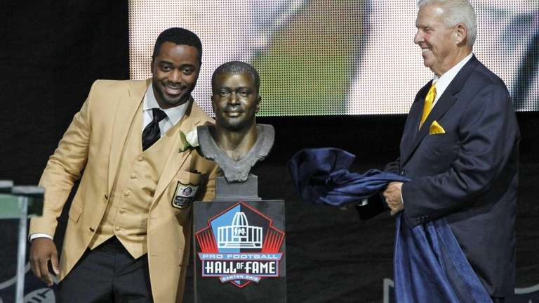 Former NFL player Curtis Martin, left, and his
