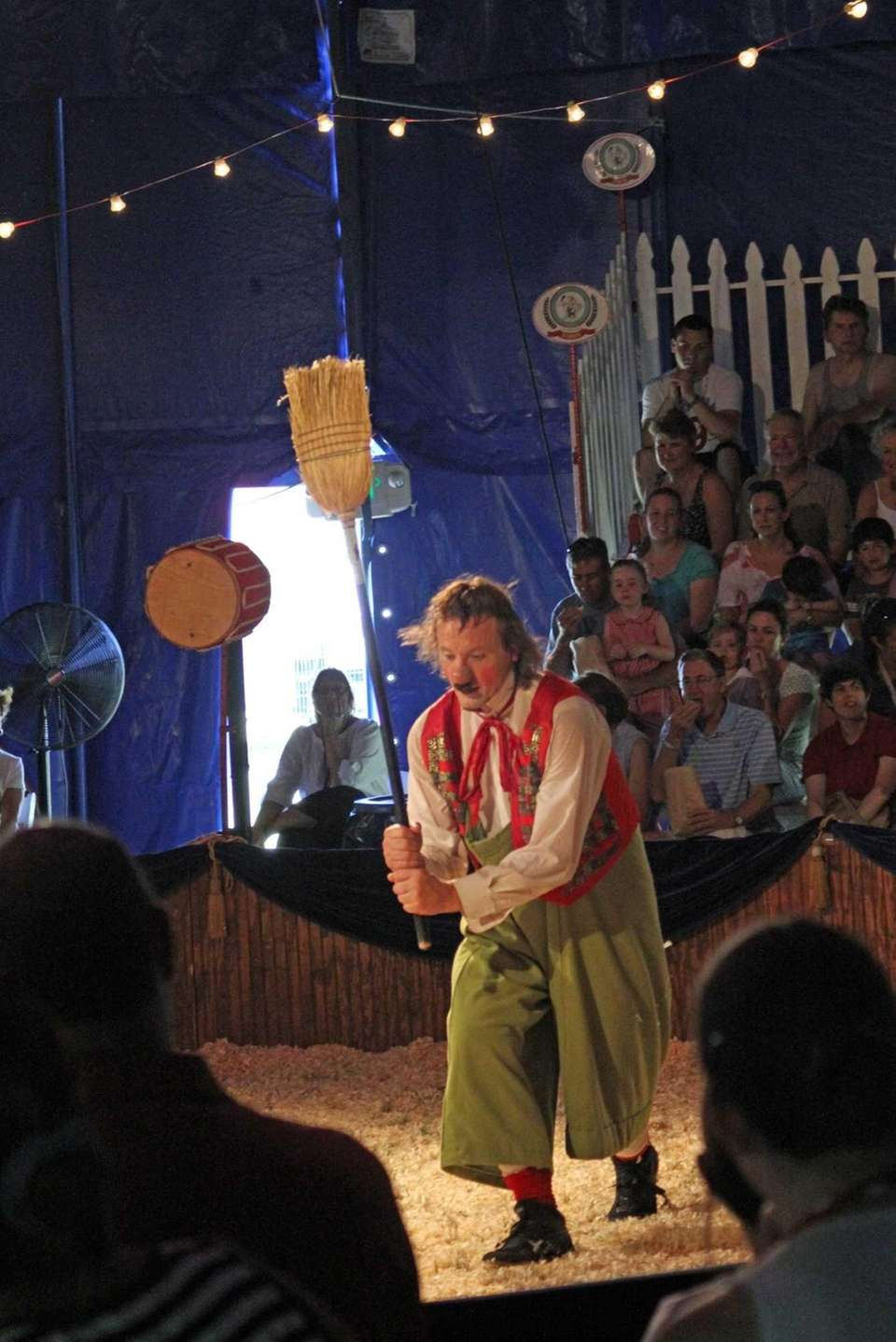 Nino the Clown entertains an audience during a