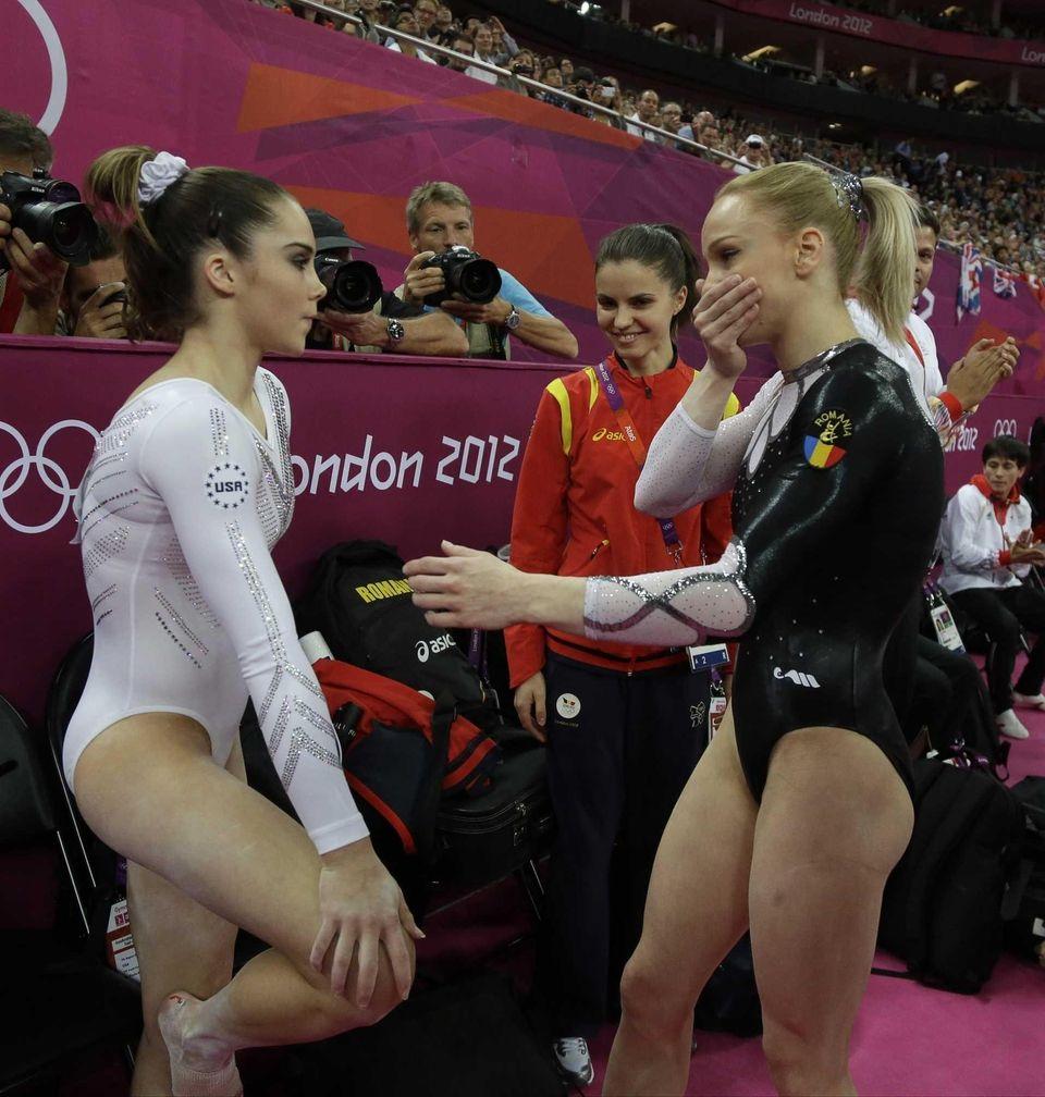 Gold medallist Romania's gymnast Sandra Raluca Izbasa, right,