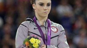 U.S. silver medalist gymnast McKayla Maroney gestures during