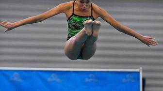Farmingdale's Lauren Mehta performs a dive during the