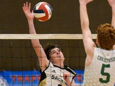 Sachem North's Luke MacPherson, left, returns the ball
