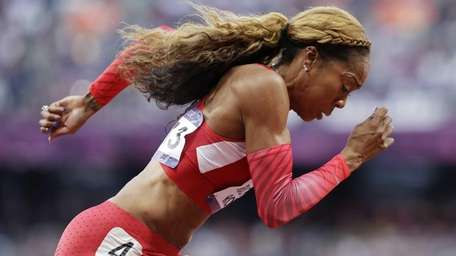 United States' Sanya Richards-Ross competes in a women's
