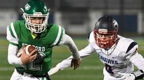 Seaford quarterback Logan Masters runs the ball ahead