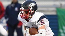 Cold Spring Harbor quarterback Richie Striano runs