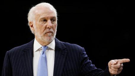 San Antonio Spurs coach Gregg Popovich points to