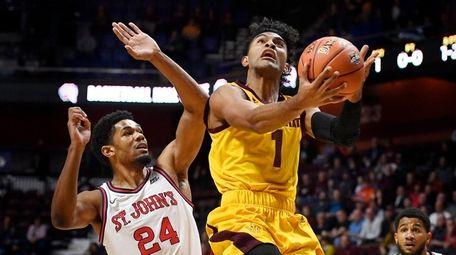 Arizona State's Remy Martin shoots as St. John's