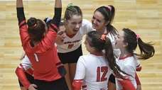 Connetquot teammates celebrate after taking both sets from