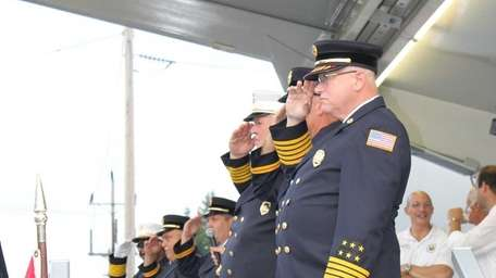 Fire officials at the judging station saluted each
