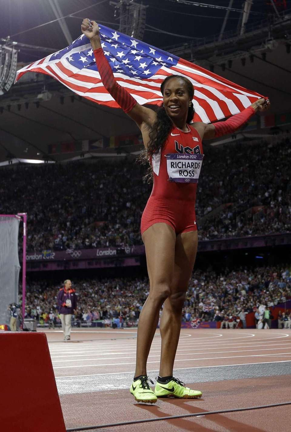 Sanya Richards-Ross from the U.S. holds her national