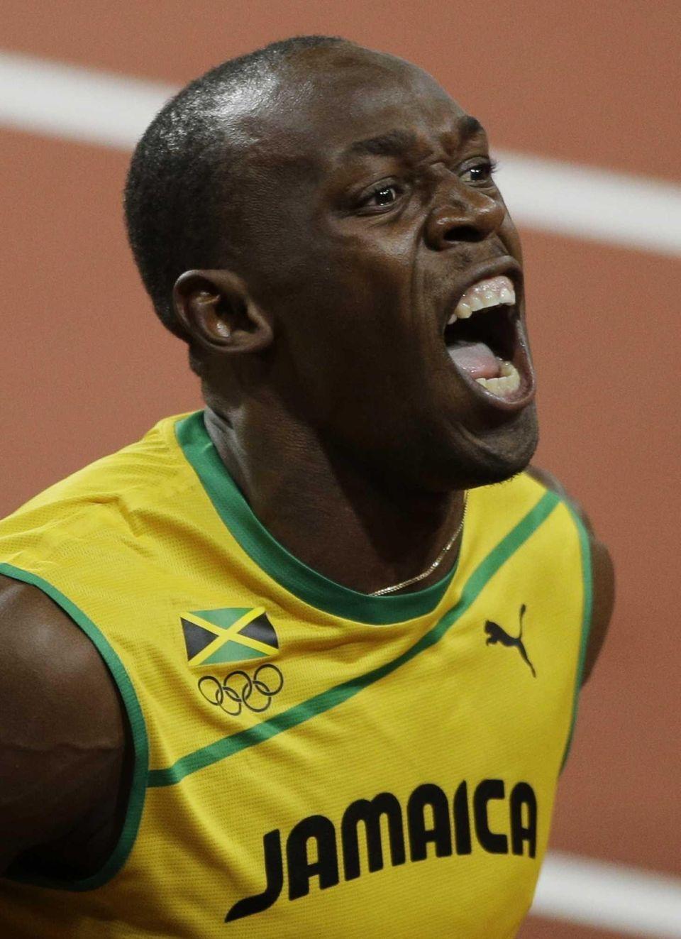 Jamaica's Usain Bolt yells after winning the men's