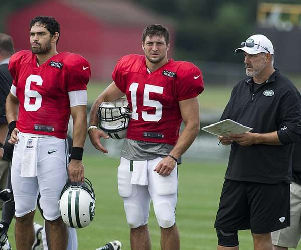 Mark Sanchez and Tim Tebow stand by quarterback