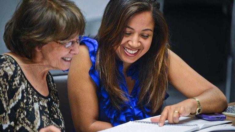 Jessie Krozer, left, of Dix Hills, tutors Esperanza
