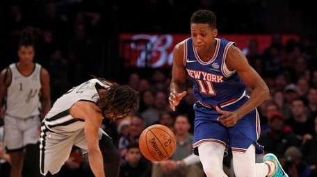 Frank Ntilikina of the Knicks steals the ball