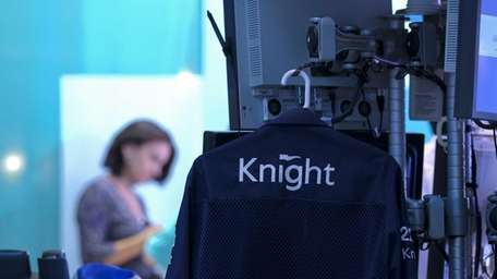 A Knight Capital Group trader's jacket hangs on