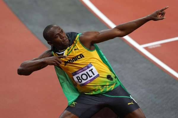 Usain Bolt of Jamaica celebrates winning gold in