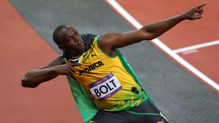 Usain Bolt of Jamaica celebrates winning gold in