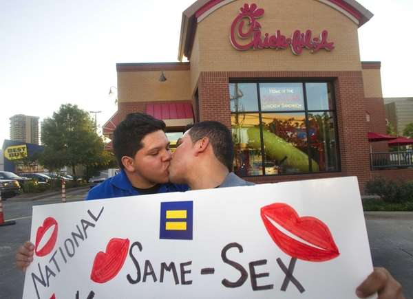 Miguel Martinez, left, kisses partner of five years,