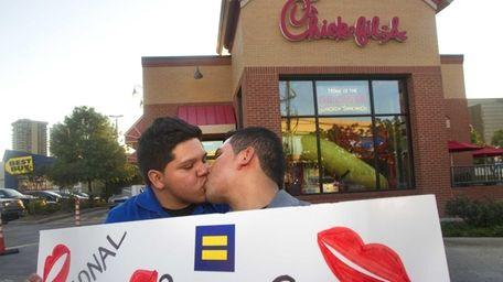 Miguel Martinez, left, kisses partner of five years,
