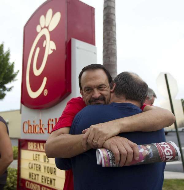 Tony Scarcellad, left, hugs his partner of 15