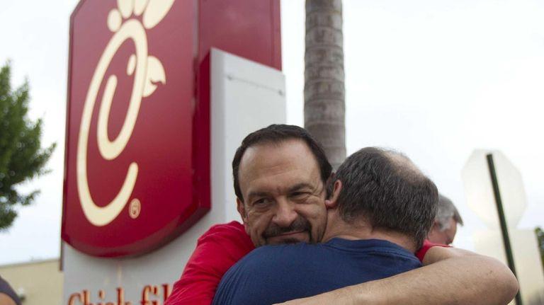 Tony Scarcellad, left, hugs his partner of 15