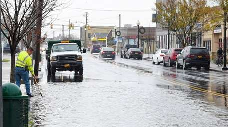 A Patchogue Village worker uses a shovel to