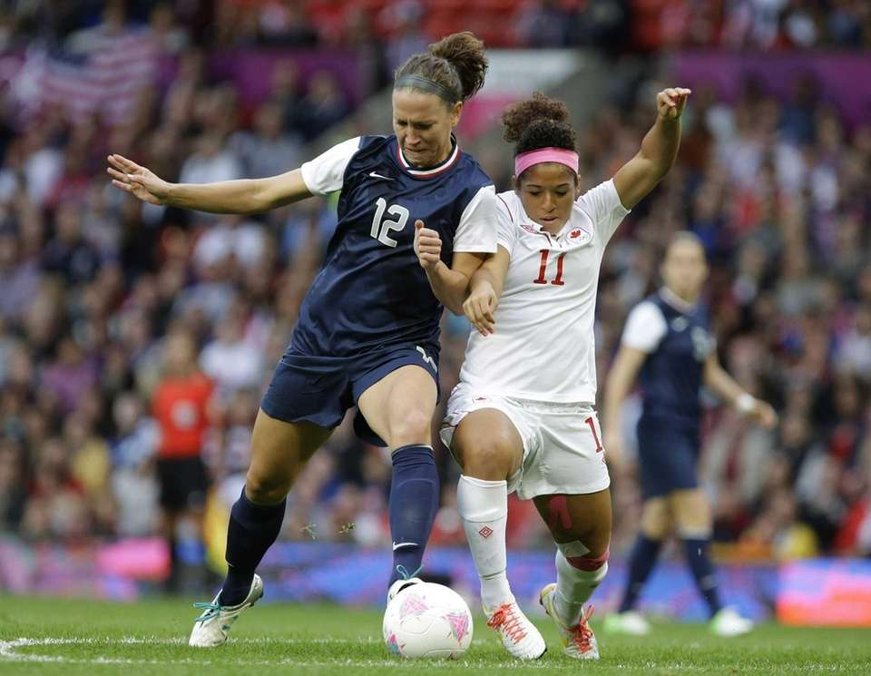Canada's Desiree Scott, right, battles for the ball