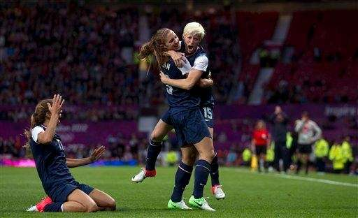 United States' Megan Rapinoe, right, celebrates with teammate