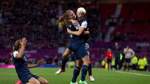 United States' Megan Rapinoe, right, celebrates with teammate