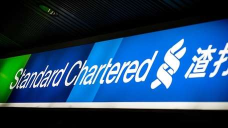 The logo of Standard Chartered bank is seen