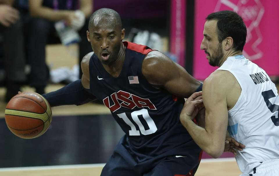 United States' Kobe Bryant, left, is defended by