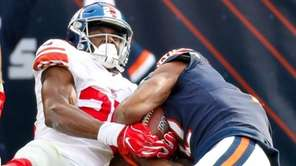 Giants defensive back Corey Ballentine tries to strip
