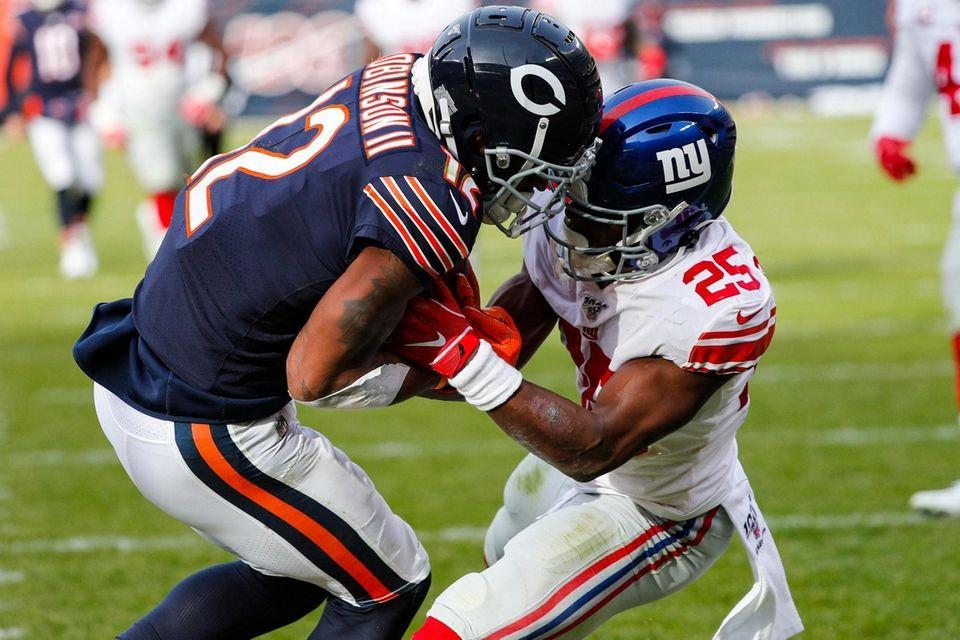 Giants defensive back Corey Ballentine tries to strip