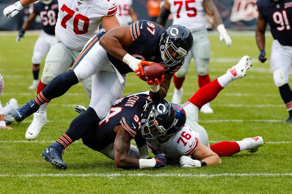Chicago Bears defensive tackle Nick Williams recovers a