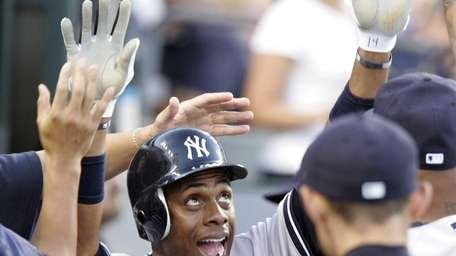 New York Yankees' Curtis Granderson celebrates in the