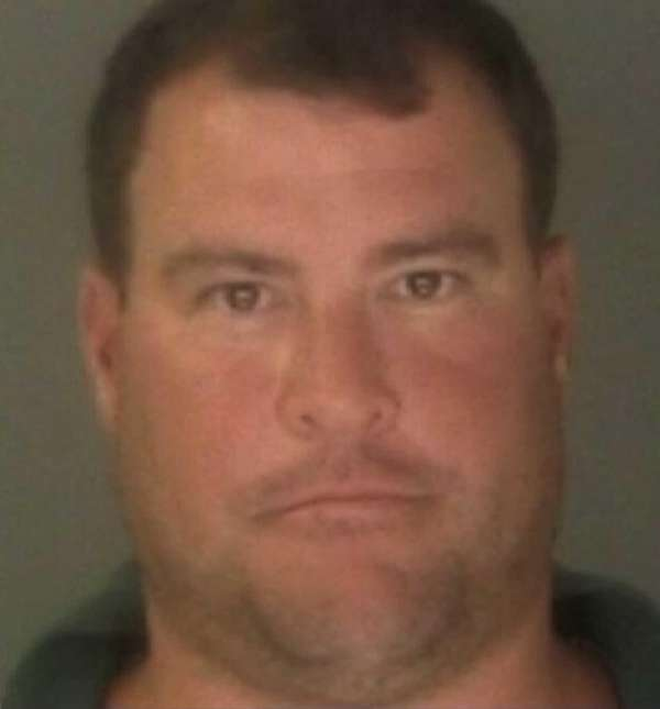 Charles D. Miller of Manhasset was charged with