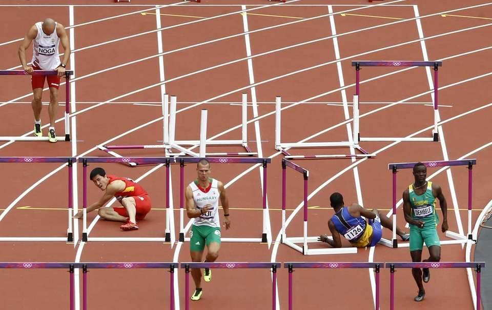 China's Liu Xiang, second left, falls as Hungary's