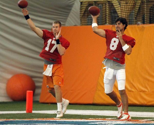 Miami Dolphins quarterbacks Ryan Tannehill, left, and Matt