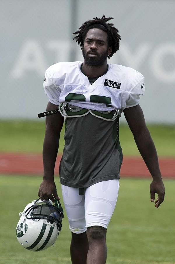Joe McKnight leaves the field after training camp
