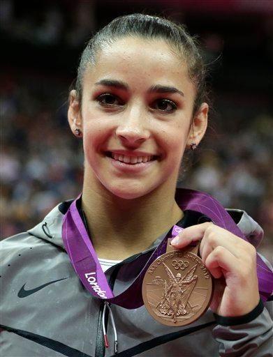 U.S. gymnast Alexandra Raisman displays her bronze medal