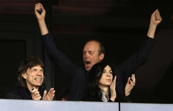 Musician Mick Jagger, left, watches an evening session